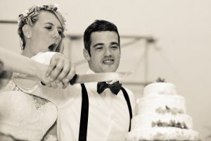 cut the cake with bride and groom